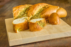 Garlic bread. With herbs on board Stock Photos