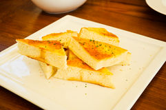 Garlic bread with herbs Stock Images