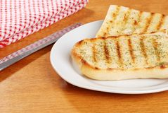Garlic bread with knife Stock Photo