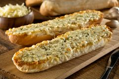 Garlic Bread with Melted Mozzarella Cheese and Herbs Royalty Free Stock Photos