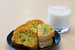 Garlic bread with milk Stock Image