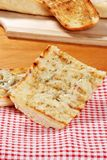 Garlic bread on red white checkered napkin Royalty Free Stock Image