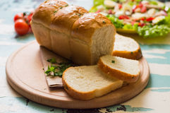Garlic bread with salad and cherry tomatoes on wooden background. Top view. Close-up. Garlic bread with salad and cherry tomatoes on wooden background Stock Images