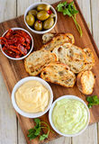 Garlic bread served with minty mayo and cheese dip. Garlic bread served with mint dip mayo dip along with olives, mint and chillies Stock Images