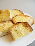 Garlic bread slices on white plate. Food close up Royalty Free Stock Photo
