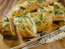 Garlic bread with spikelet ear baguette Royalty Free Stock Photos