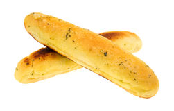 Garlic bread sticks with one overly done Royalty Free Stock Image