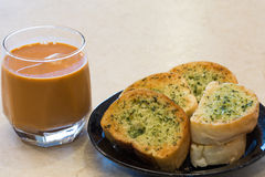Garlic bread with  tea Royalty Free Stock Image