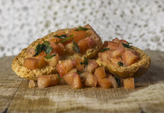 Garlic bread. With tomatoes and parsley on wooden cutting board Royalty Free Stock Photo