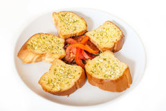 Garlic bread with tomatoes. Sliced garlic bread with tomatoes Royalty Free Stock Photos