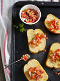 Garlic bread  topped with tomato, garlic and herbs Stock Photography