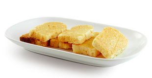 Garlic bread on white plate Stock Images