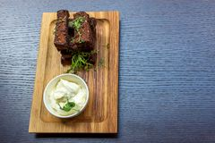 Garlic bread on wooden platter Stock Photo