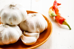 Garlic. In brown plate with paprika Stock Photo