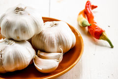 Garlic. In brown plate with paprika Royalty Free Stock Image