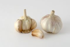 The garlic bulb and cloves. On the background Royalty Free Stock Images