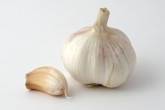 The garlic bulb and cloves. On the background Stock Images