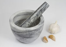 Garlic Bulb and cloves with Pestle and Mortar Royalty Free Stock Photos