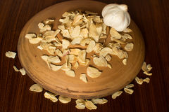 Garlic bulb and flakes Stock Images