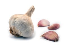 Garlic Bulb with some garlic cloves Royalty Free Stock Photos