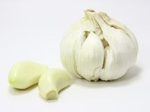 Garlic bulb and two cloves Royalty Free Stock Photography