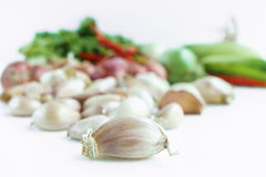 Garlic bulb with vegetable in background. Isolated Stock Photography