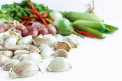 Garlic bulb with vegetable in background. Isolated Royalty Free Stock Photo
