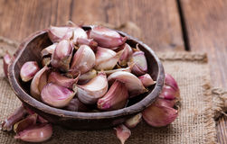 Garlic Bulbs. (close-up shot) on dark wooden background Royalty Free Stock Images