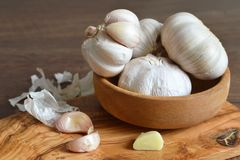 Garlic bulbs and garlic cloves. On wooden background Royalty Free Stock Photo