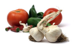 Garlic bulbs with veggies Royalty Free Stock Photos