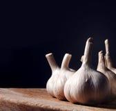 Garlic bulbs on wooden table Royalty Free Stock Photos