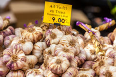 Garlic bunches in a farmers market Royalty Free Stock Images
