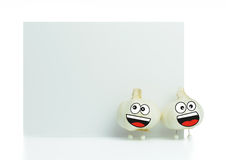 Garlic cartoon character. With blank white board Stock Photography