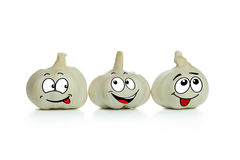 Garlic cartoon characters. Three lovely garlic cartoon characters in a low Royalty Free Stock Image
