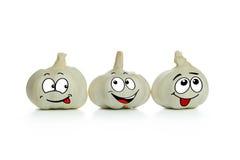 Garlic cartoon characters. Three lovely garlic cartoon characters in a low royalty free stock image