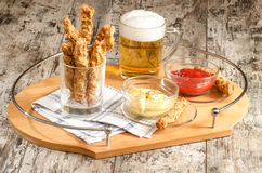 Garlic cheese bread sticks and cup of beer Stock Photography
