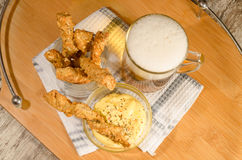 Garlic cheese bread sticks and cup of beer Stock Images