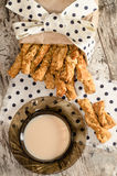 Garlic cheese bread sticks and cup of black cwith milk Stock Photo