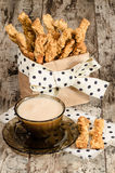Garlic cheese bread sticks and cup of black tea with milk Stock Photo