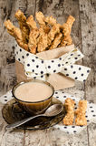 Garlic cheese bread sticks and cup of black tea with milk Stock Images