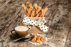 Garlic cheese bread sticks and cup of black tea with milk Royalty Free Stock Photo