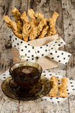 Garlic cheese bread sticks and cup of black tea Stock Images