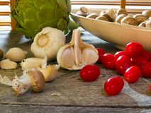 Garlic, cherry tomatoes, crimini mushrooms... Stock Image