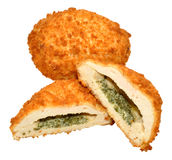 Garlic Chicken Kiev. Two cooked garlic chicken kiev isolated on a white background royalty free stock photography