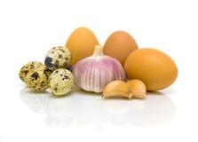 Garlic, chicken and quail eggs Royalty Free Stock Photos