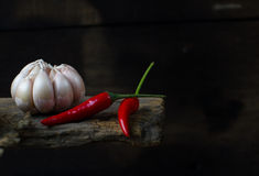 Garlic. And chilli on wood background Royalty Free Stock Photography