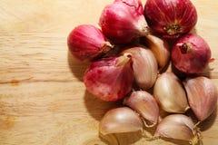Garlic on Chopping Block Stock Image