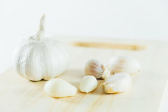 Garlic on chopping block Stock Image