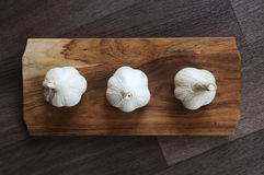 Garlic. On chopping wooden board. Indoor photography royalty free stock photo