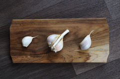 Garlic. On chopping wooden board. Indoor photography stock photo